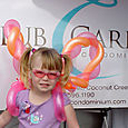 Miami: real estate, condo sales promotion event, kids & adults enjoy balloon art entertainment